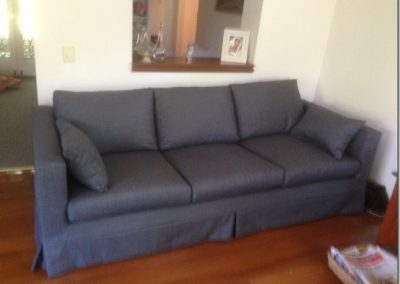 Slip cover on sofa in Manly